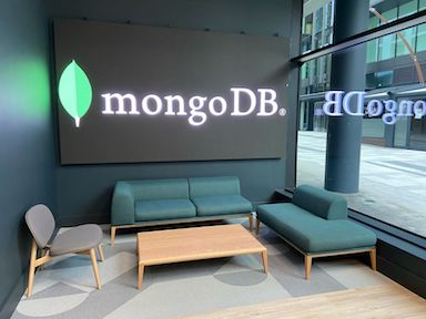 lounge area at an office building with a digital screen